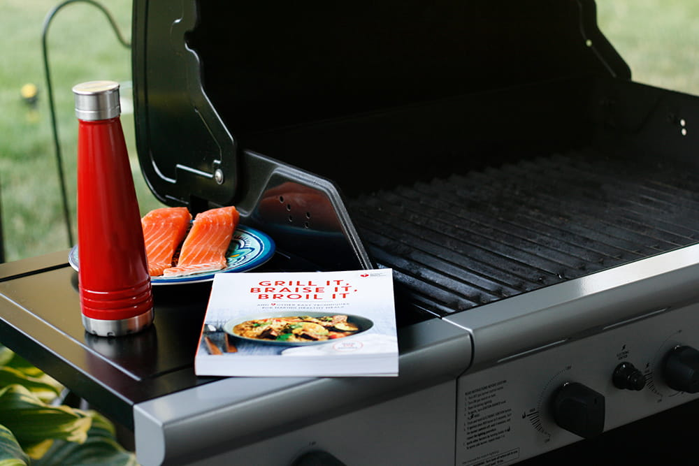 grill cookbook and water bottle with salmon