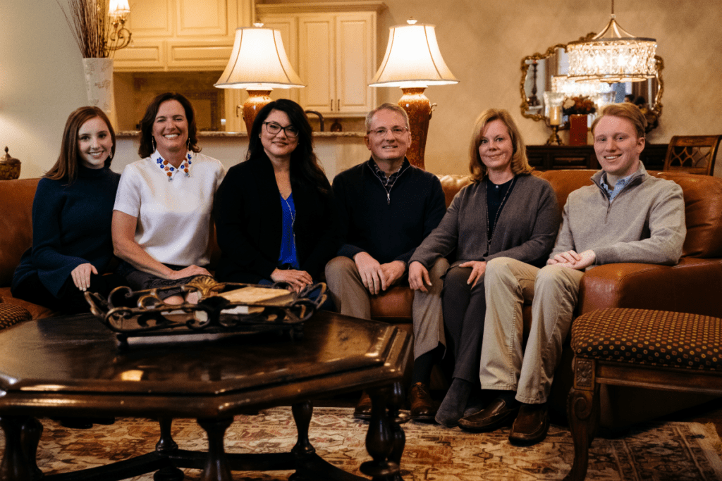 AHA president Dr. John Warner, center, with his lifesavers. From left: daughter Lauren Warner, Dr. Tia Raymond, Janie Garza, wife Lisa Warner and son Jacob Warner.</