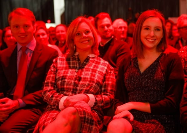 Jacob, Lisa and Lauren watching John deliver his presidential address. (Photo by American Heart Association)