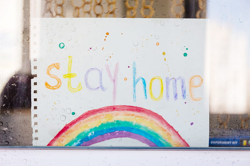 stay home crayon rainbow in window