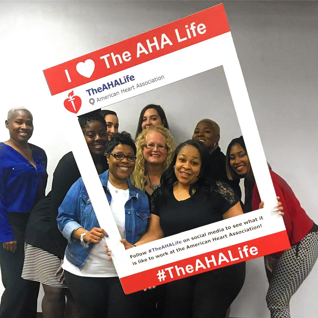 Group of AHA employees posing for social media photo