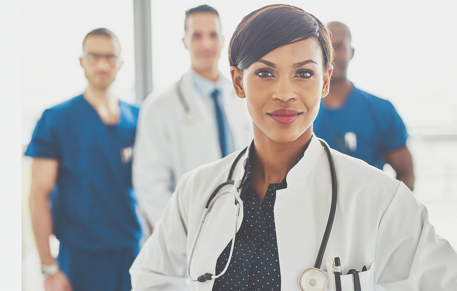 Black Female Doctor Leading Medical Team