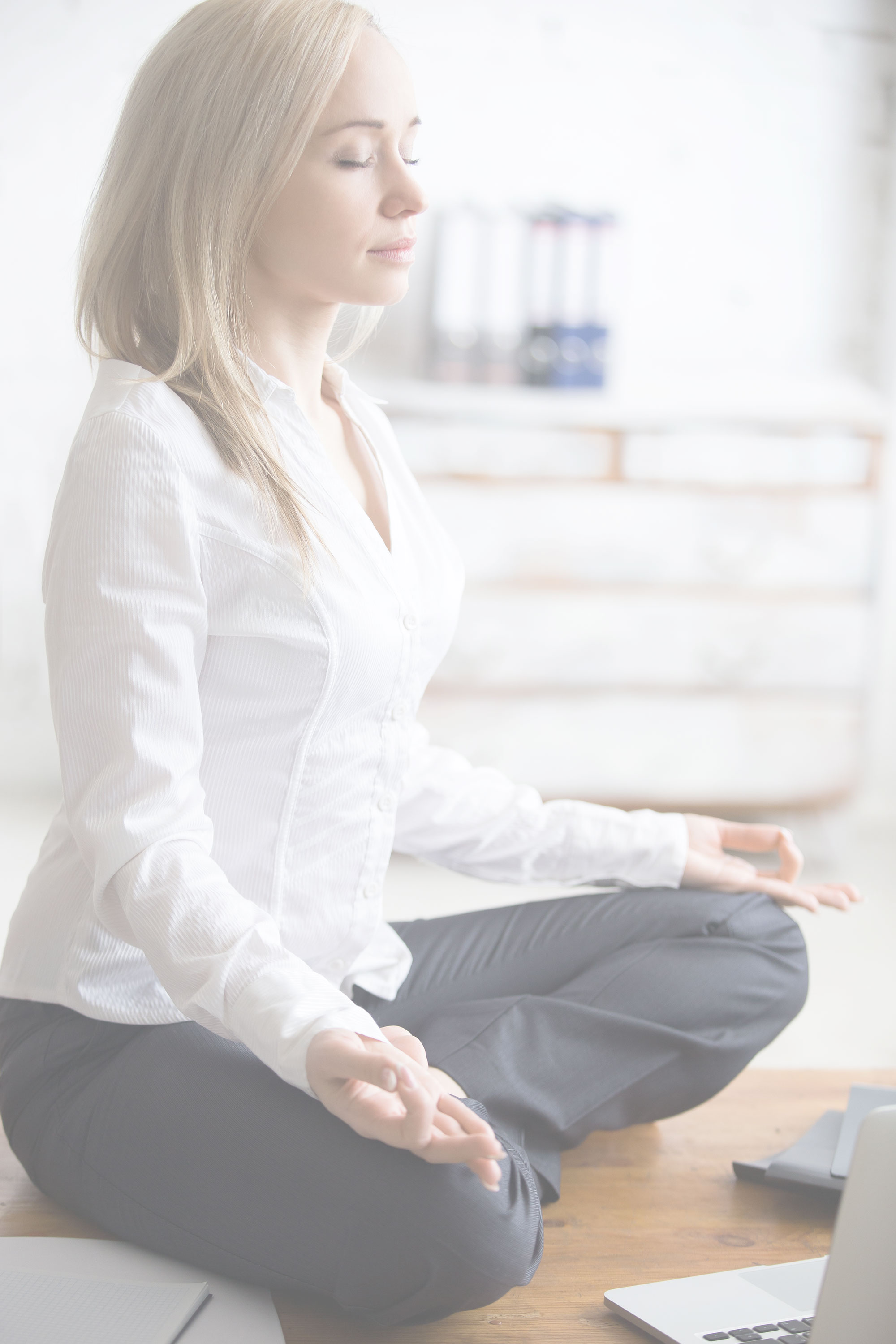 Businesswoman doing yoga in her office