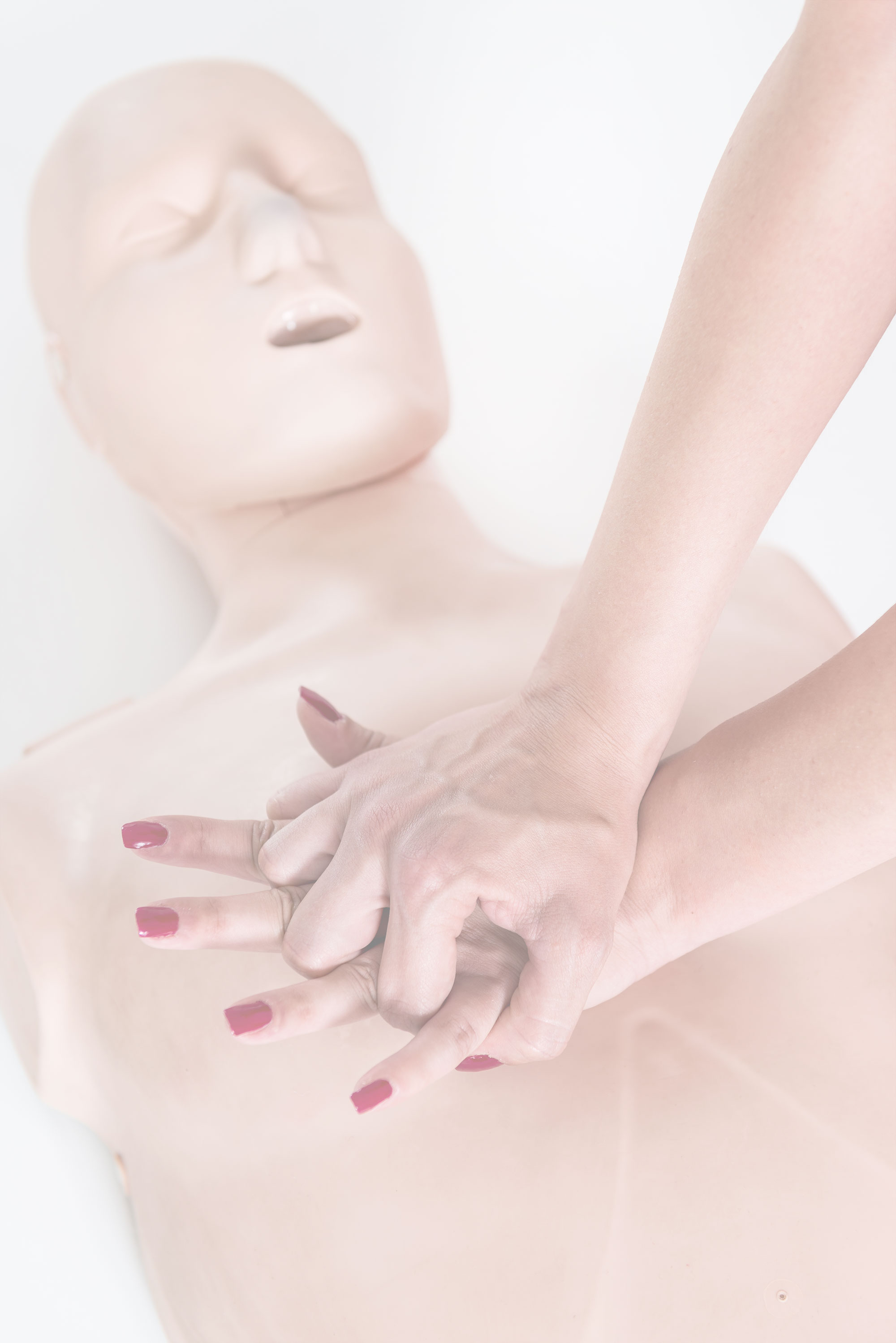 Woman performs CPR on an adult mannequin