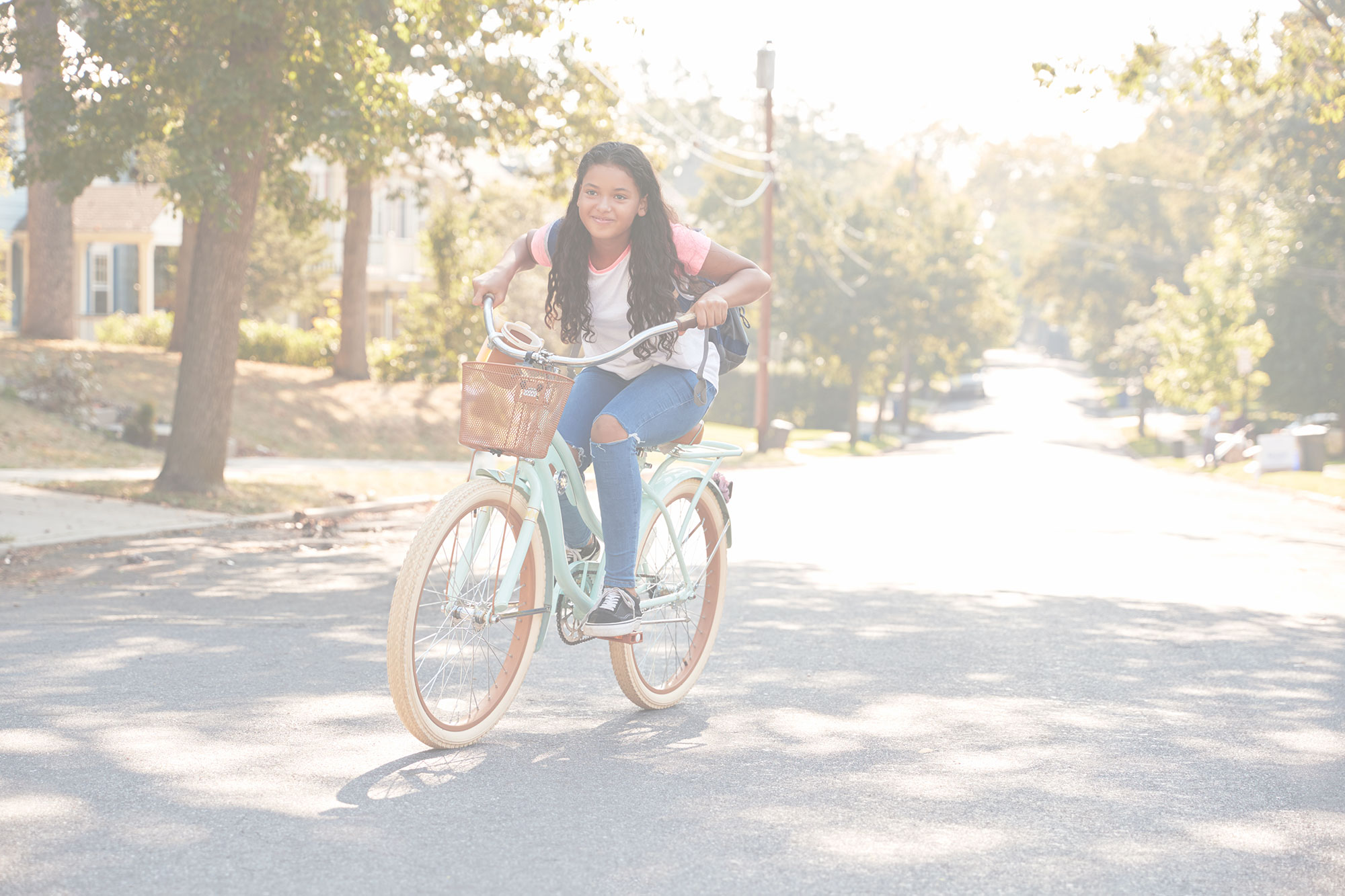 Young girl riding a bike in the street