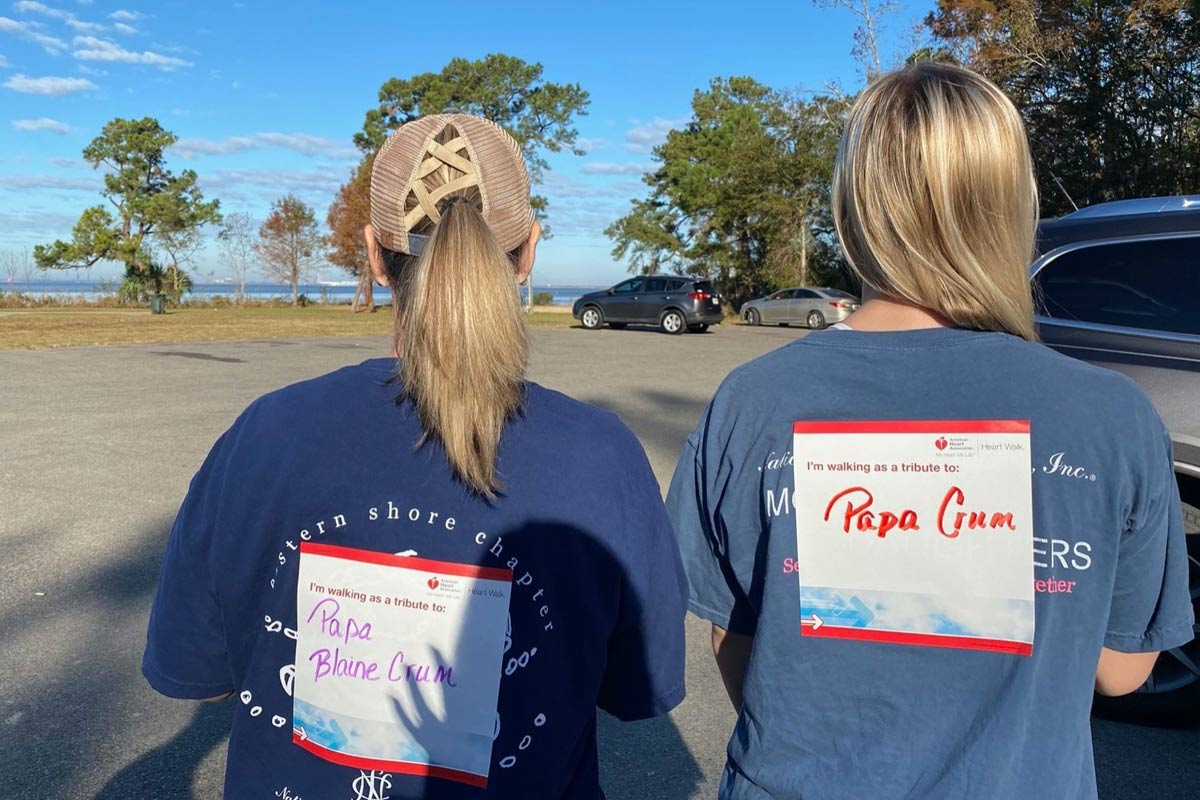 two women wearing tribute stickers on their backs