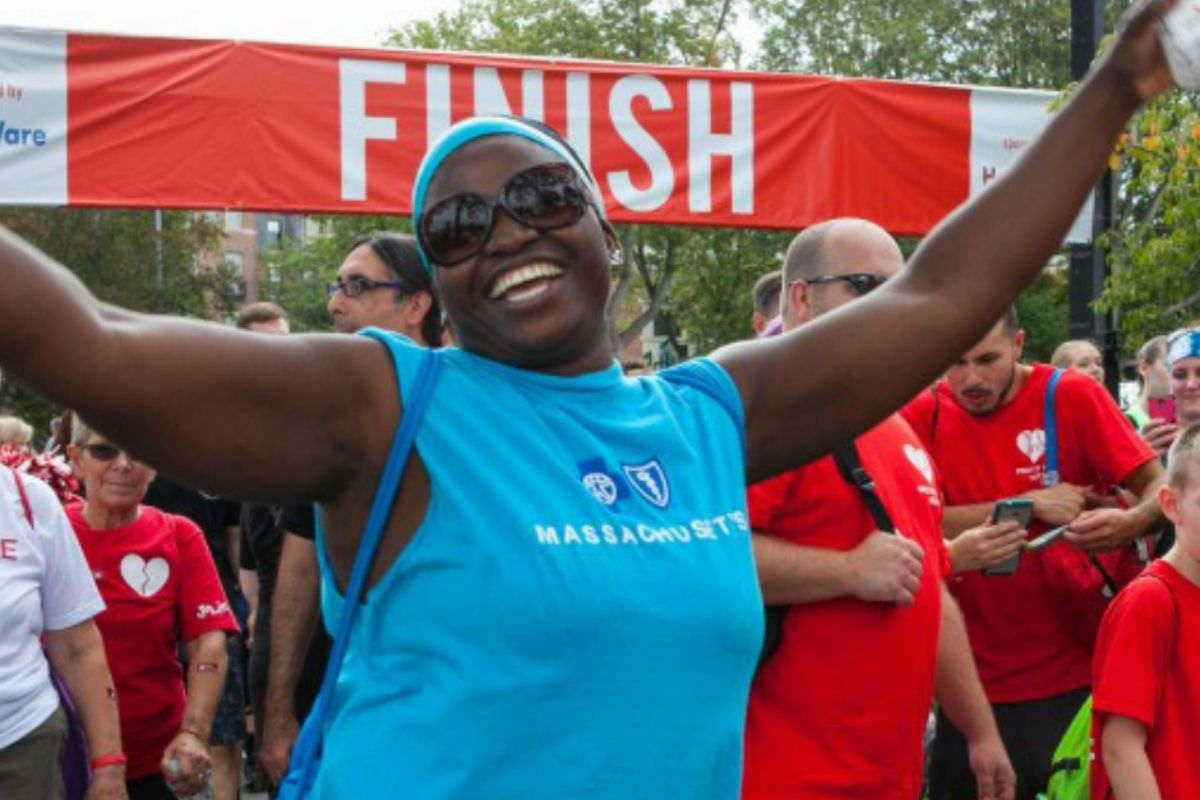smiling woman at finish line