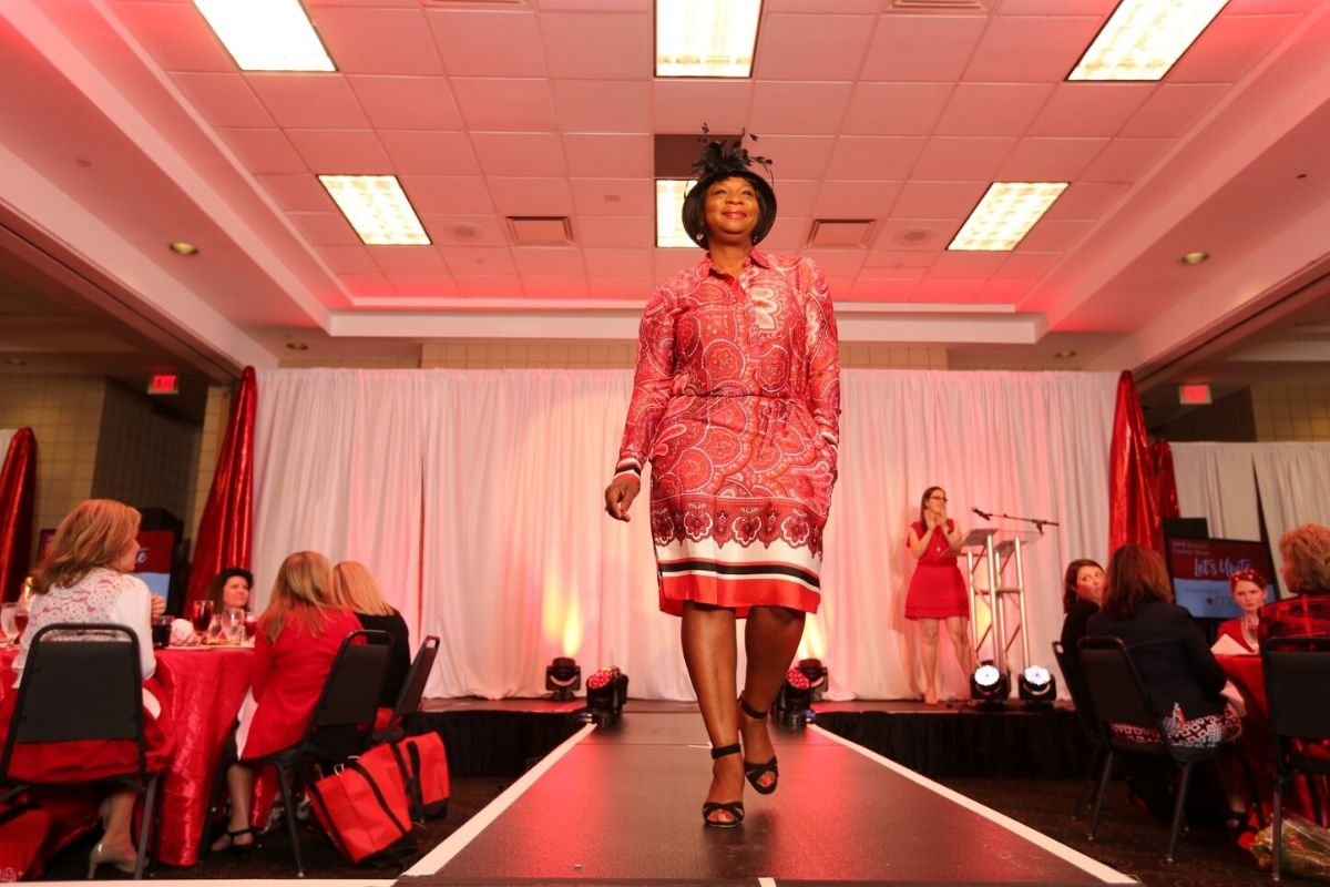 woman in red walking the catwalk