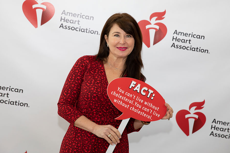woman holding Fact sign at AHA event