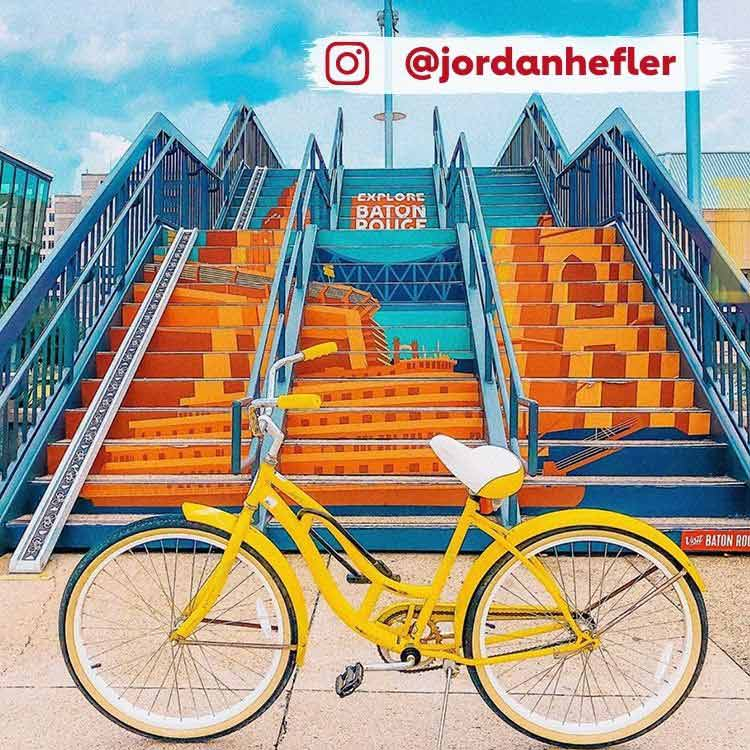 yellow bike parked in front of staircase