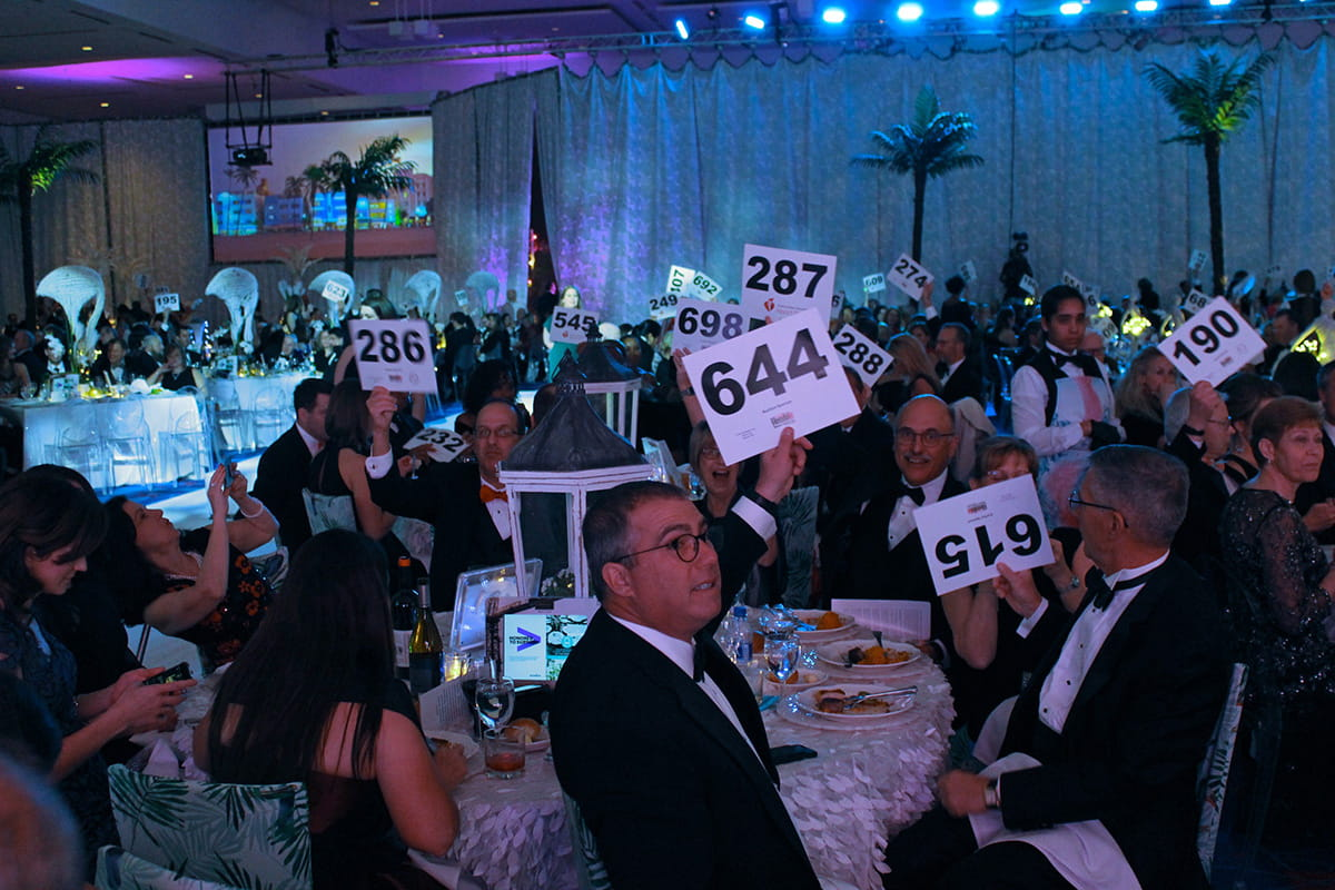 auction bidders at Charlotte Heart Ball