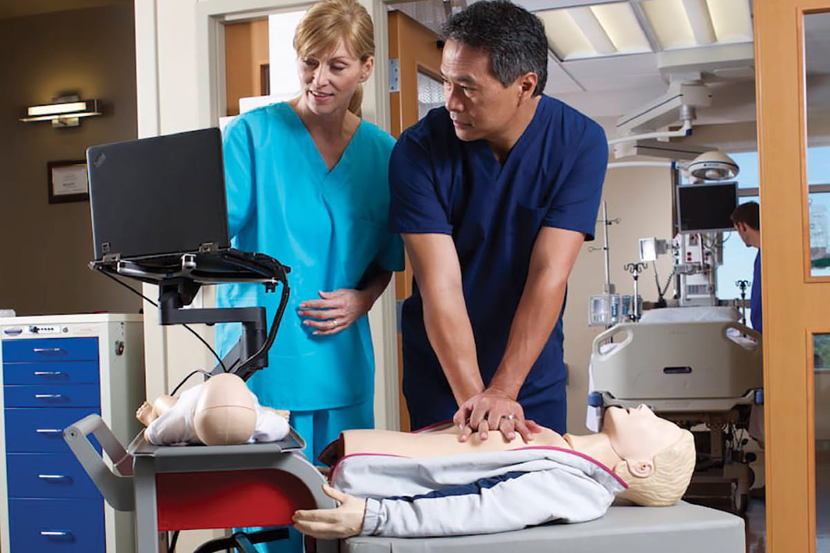 Medical professionals practicing Hands Free CPR with a dummy