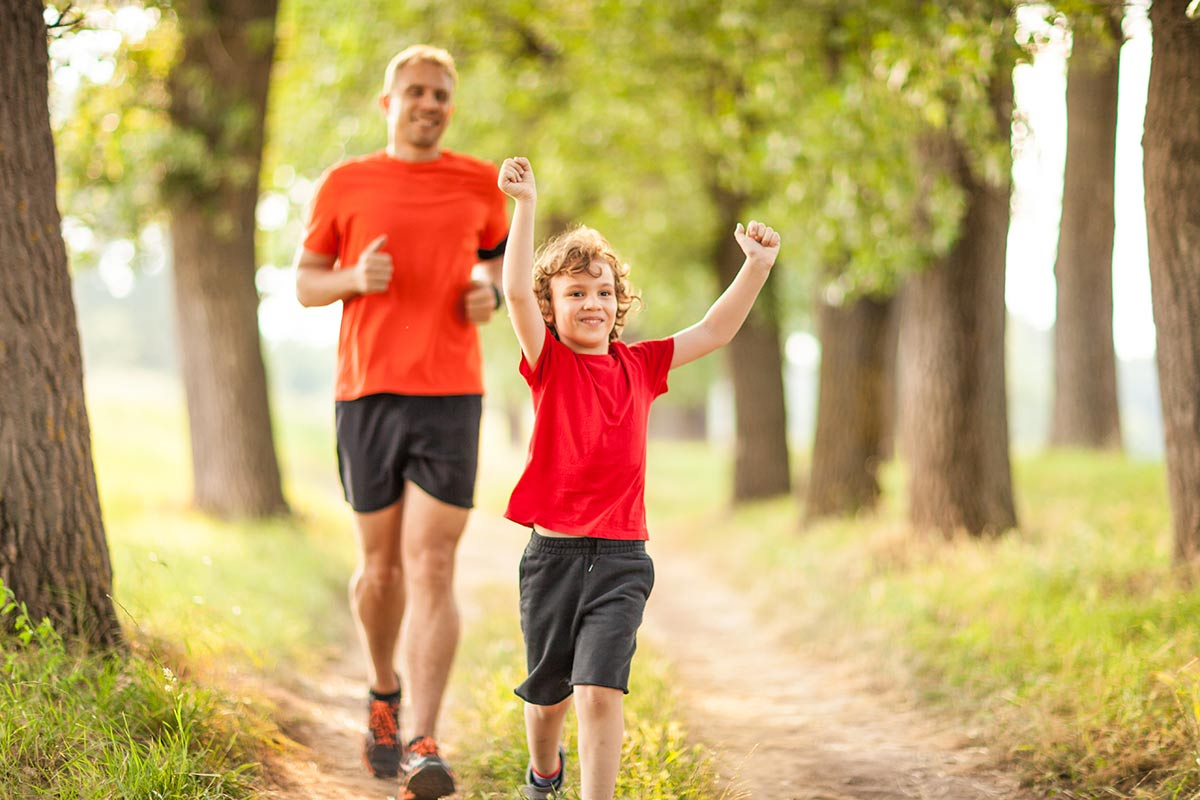 Dad and son jogging outdoors