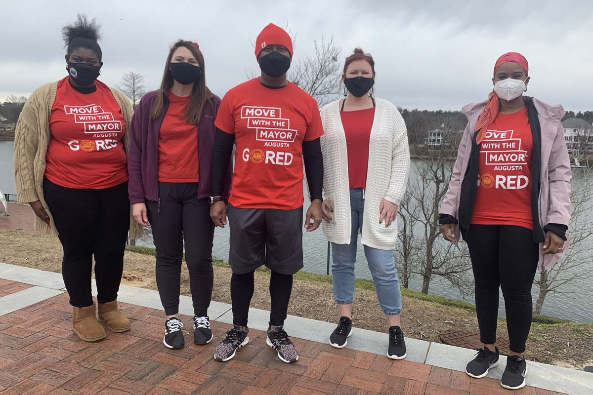 group wearing masks and red t-shirts