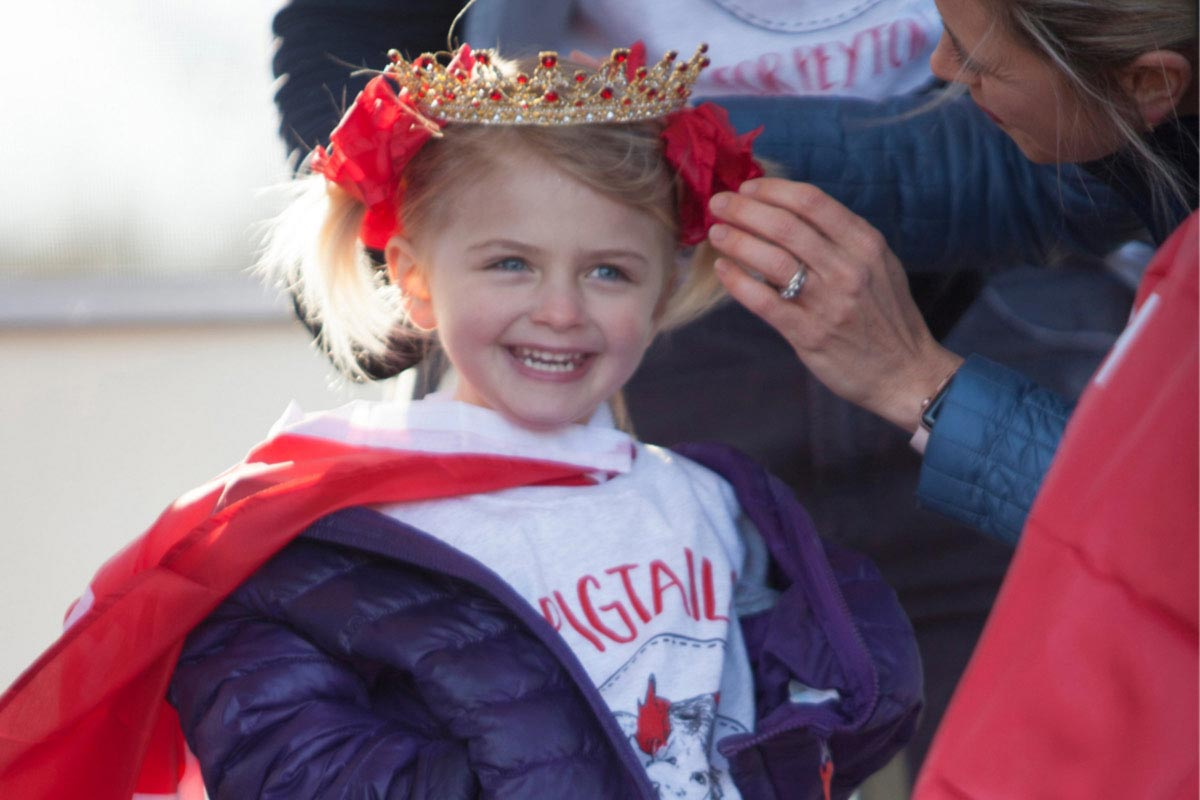 little girl wearing gold crown
