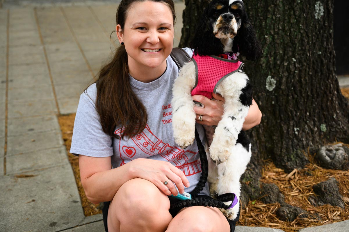 woman posing with her dog