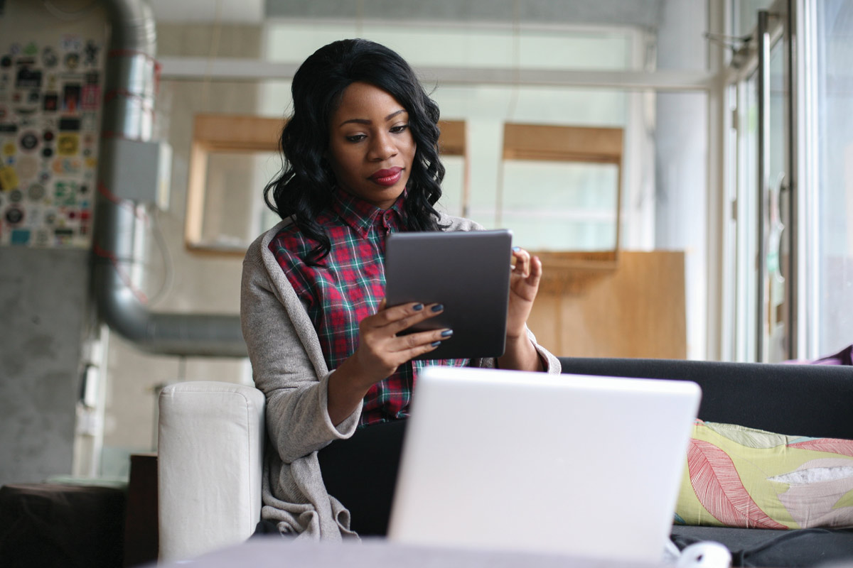 woman at an office using a tablet