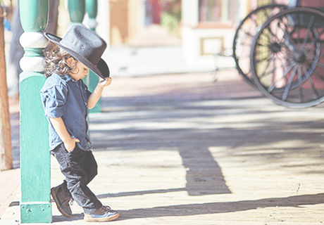 Child in Tucson Arizona wearing cowboy hat