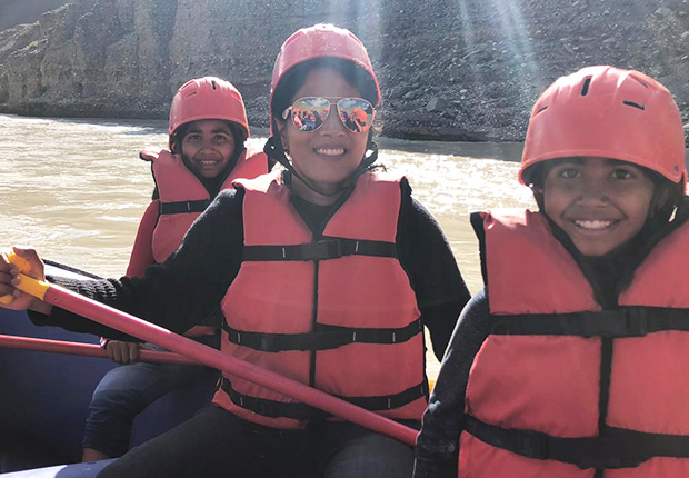Dr. Neelima Vallurupalli and her kids on a water rafting trip