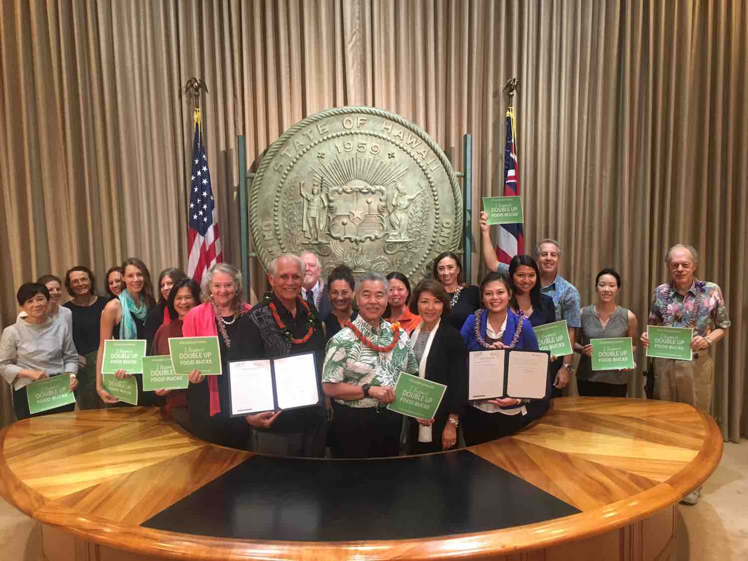 group stands with Governor Ige after he signed into law act 153