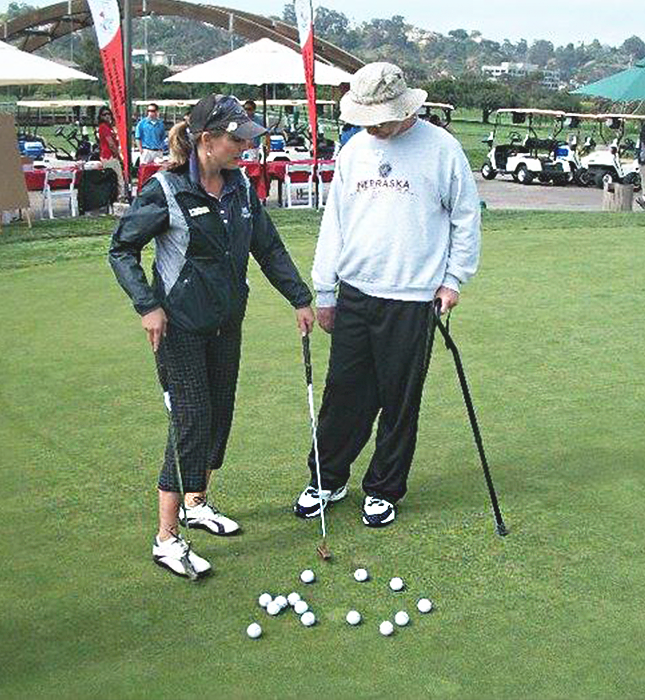 woman giving man golf tips