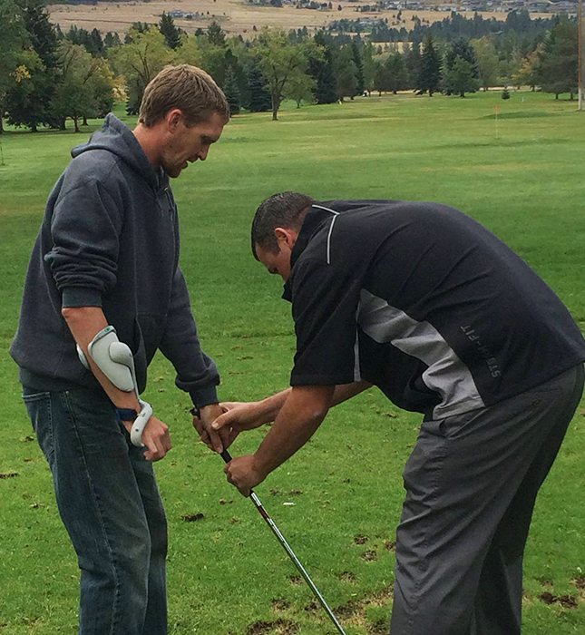 Photo of stroke survivor learning to golf