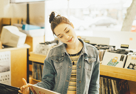 girl looking through records in Seattle store