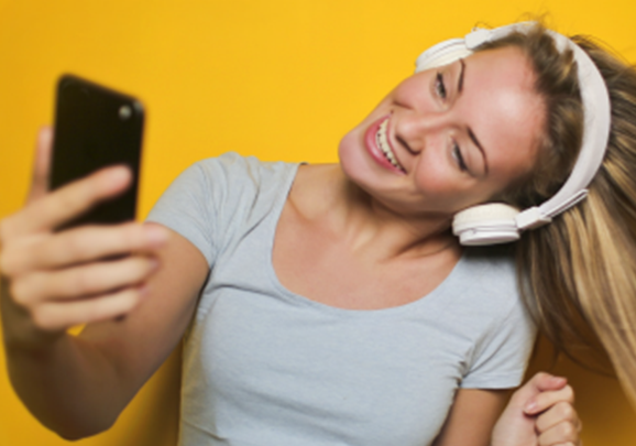 Girl taking a selfie with headphones on