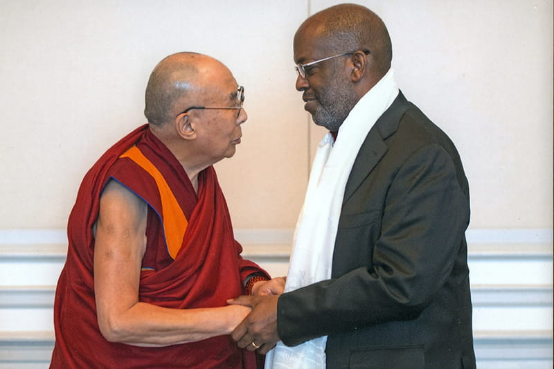 Bernard J Tyson shaking hands with the Dalai Lama
