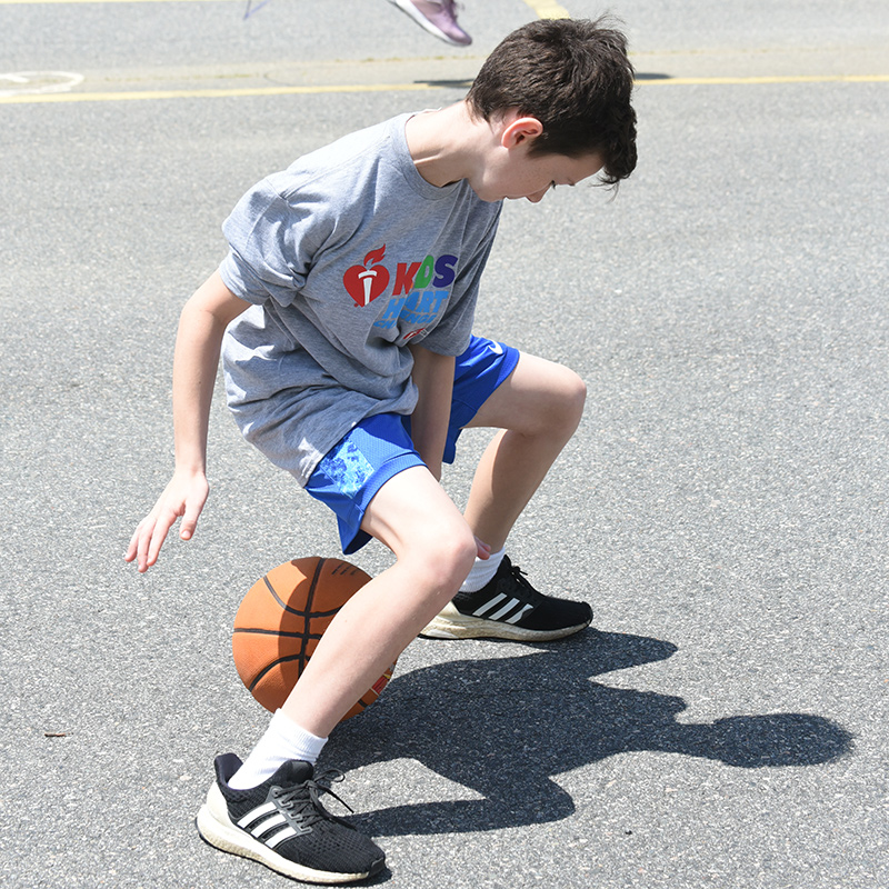 boy plays in Hoops for Heart