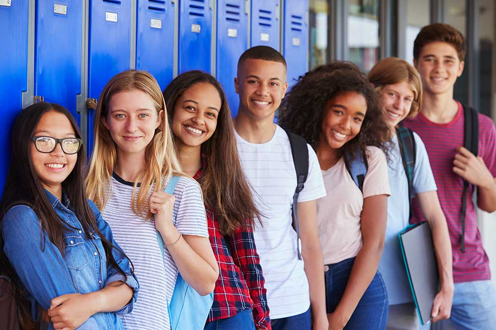 students standing in front of lockers