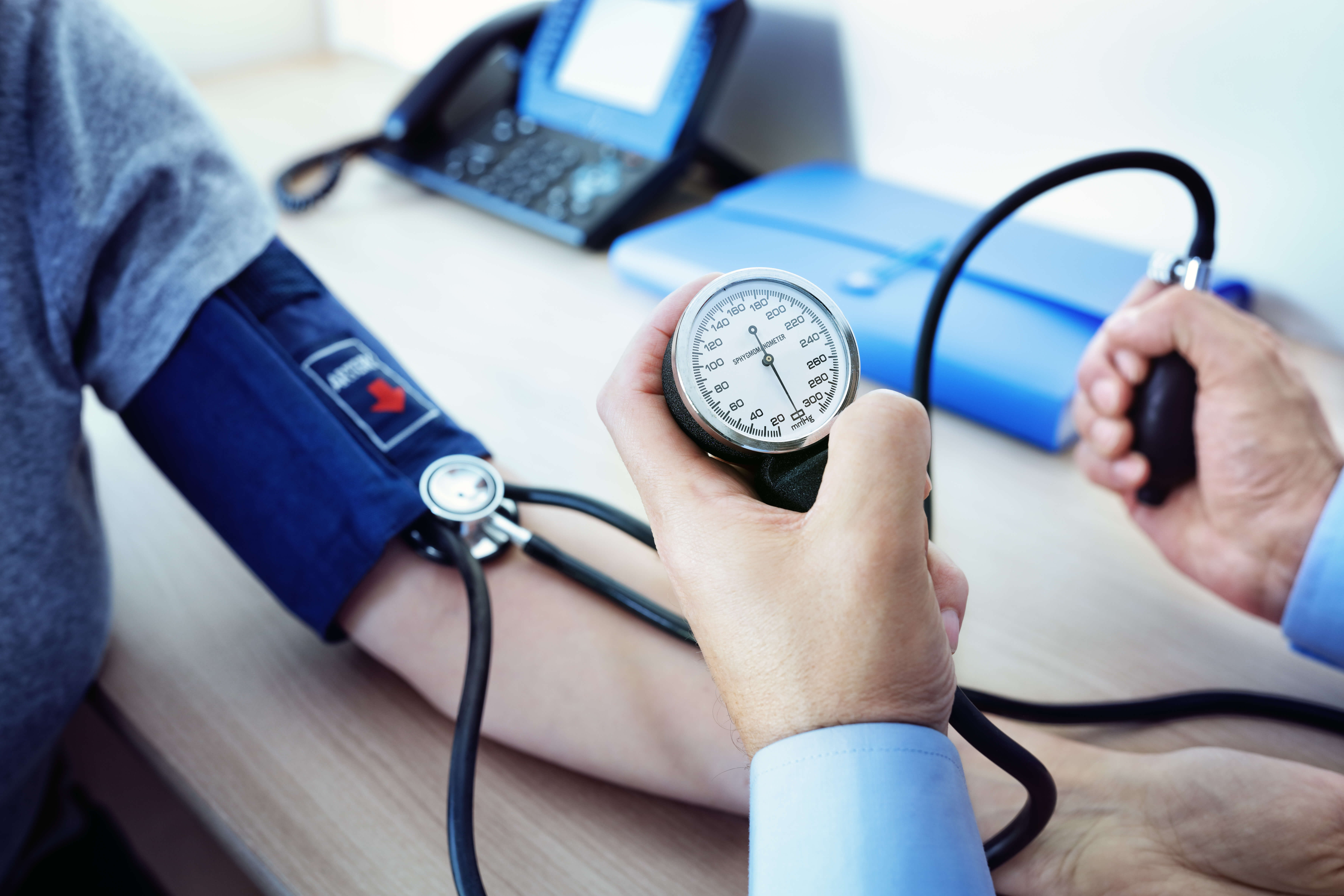 doctor measuring blood pressure of patient