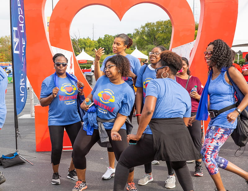 group dancing at Heart Walk finish line