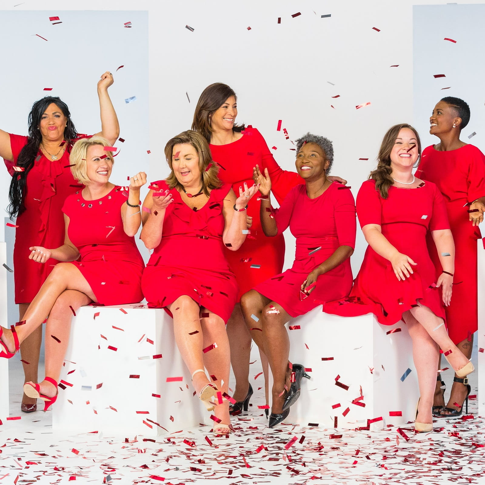 group of women wearing red