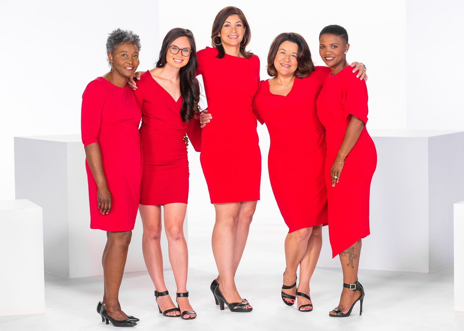 5 women wearing red
