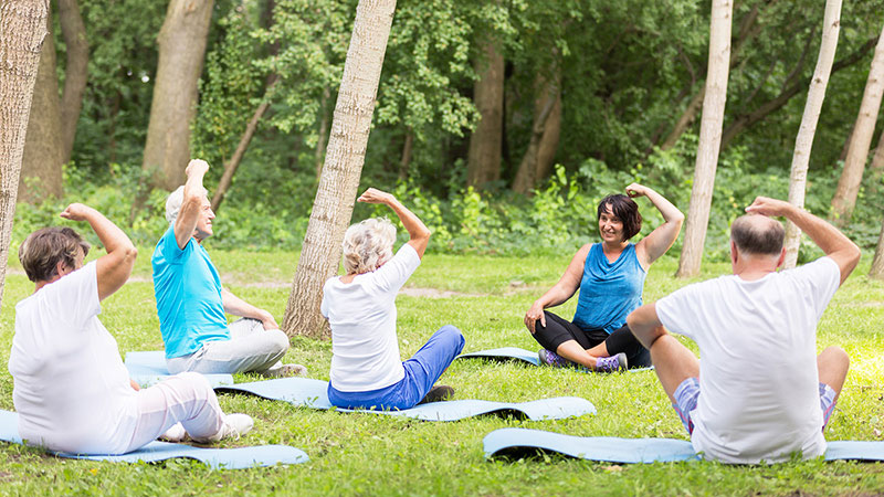 active grandparents excercising in garden