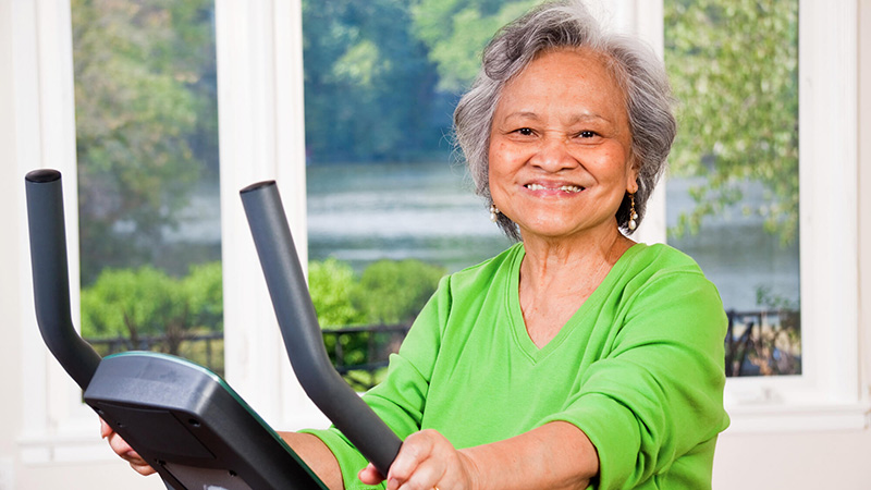 senior woman on treadmill portrait
