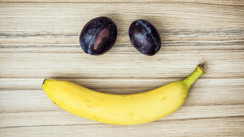 Banana and grape smiley face