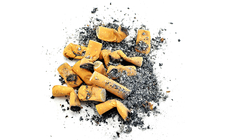 Pile of cigarette ends and ash