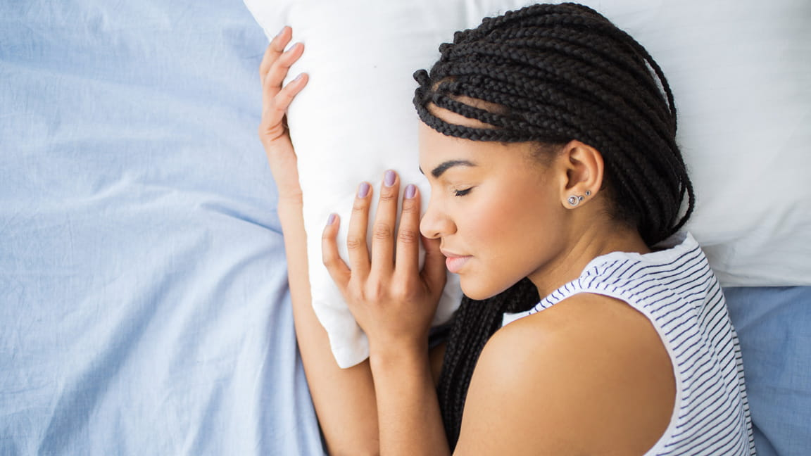 African American woman with braids sleeping