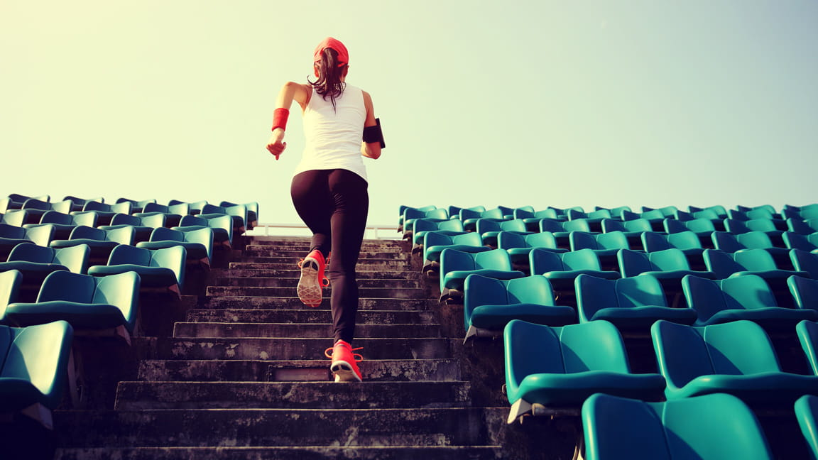 woman running up stairs outdoors