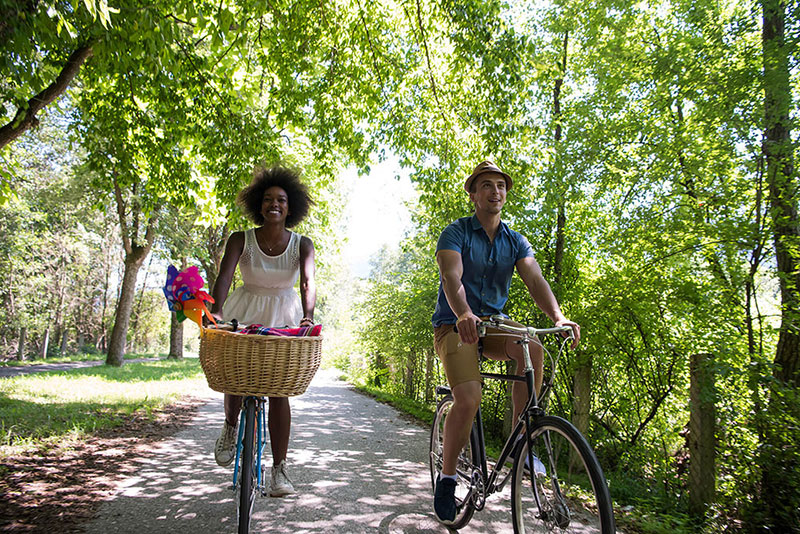 young couple having joyful bike ride