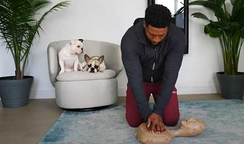 Jocko Sims performs hands only cpr