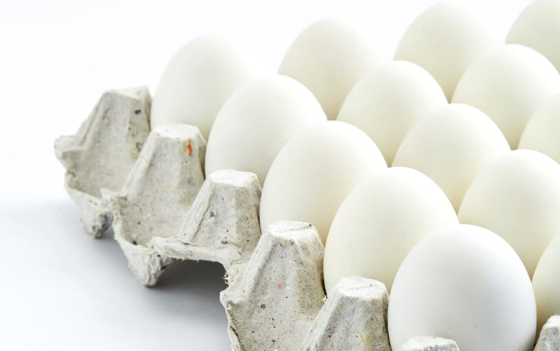 Photo of a dozen white eggs