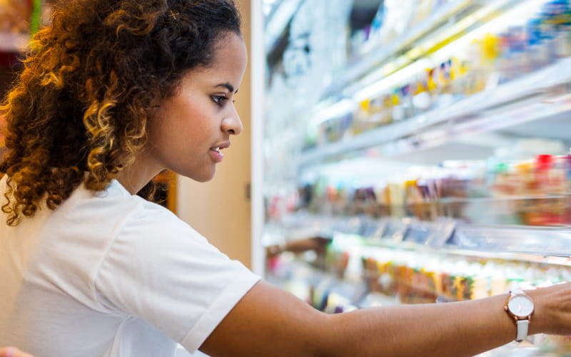 Woman looking at convenience store food.