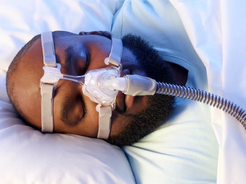 African-American man with CPAP mask.