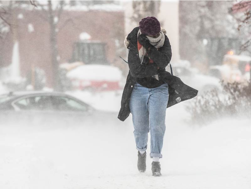 Person walking in blowing snow.
