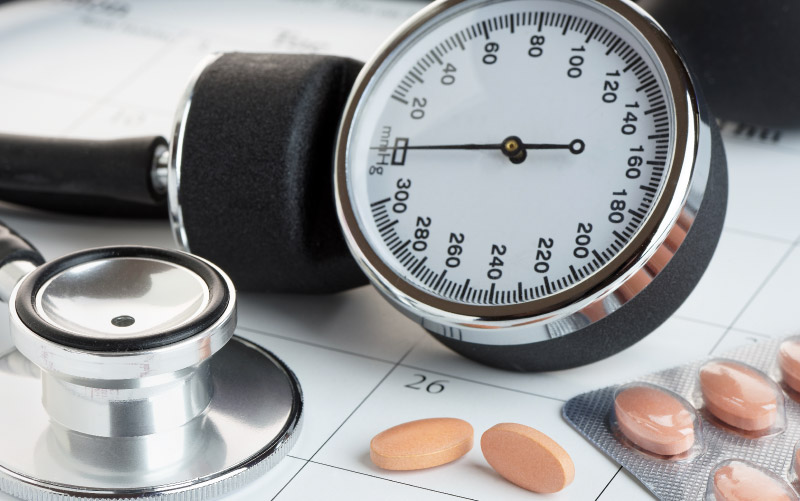 Blood pressure cuff and meds. (iStock)