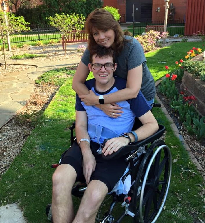 Christian with mom, Marla, his first day outdoors during stroke rehabilitation. (Photo courtesy of Christian England-Sullivan)