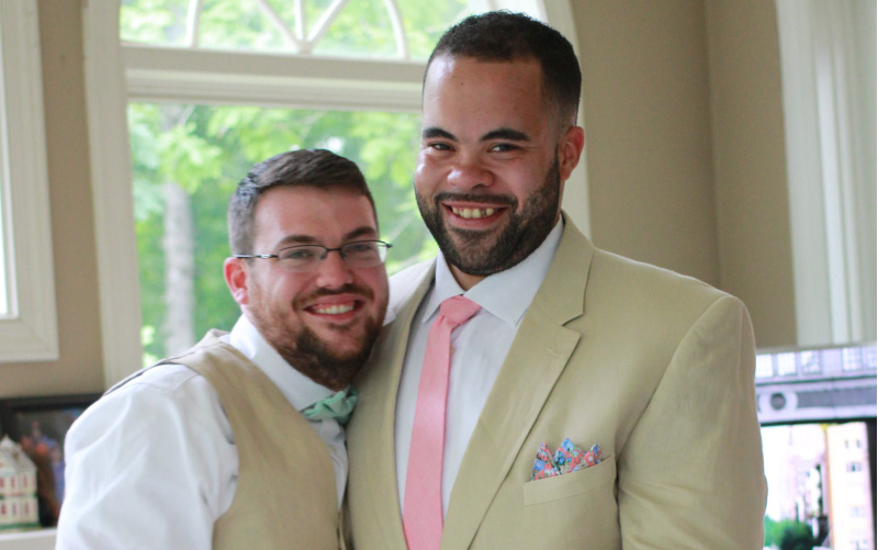 Christian England-Sullivan (left) with husband Justin on their wedding day. (Photo couresty of Caitlyn England)